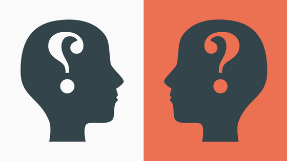 Two people looking at each other with question marks in their minds